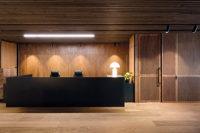 Spotted gum and cedar are used in the reception area, including a signature circular pattern perforated across standout panels of the gum.