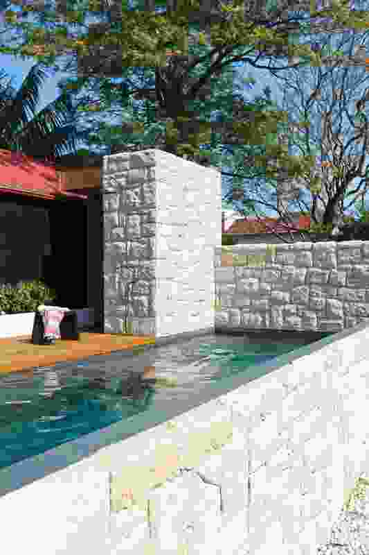 The sandstone pool exterior morphs conceals a small change room.