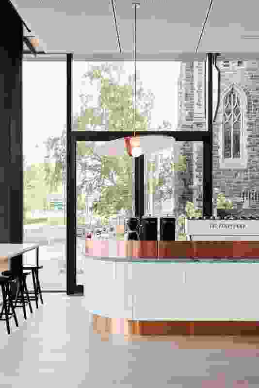 The curved coffee station is an elegant place for visitors to wait for their morning coffee.