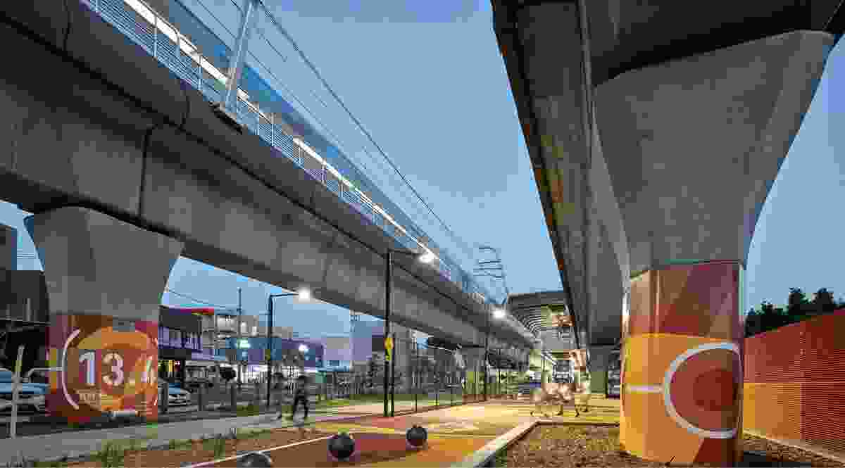 The elevated tracks have been split to reduce the visual bulk and to allow light and rainfall into the linear parks such as this one at Carnegie Station.