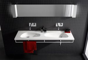 Generous storage space and an elegant chrome-plated hand towel rail deliver convenience with Laufen's new double washbasin.