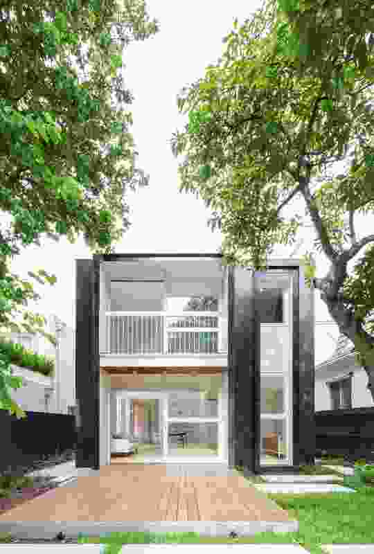 The box-like rear facade is animated by material choice and the deep window reveals.