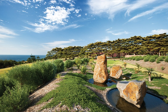 Dramatic rocks tower from Circular ponds in the water feature by artist Ashika Ostapkowicz.
