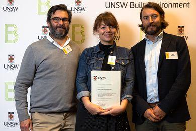 Arcadia principals Alex Longley and Michael Barnett present UNSW graduate Kaylie Salvatori with the Arcadia scholarship in 2019.