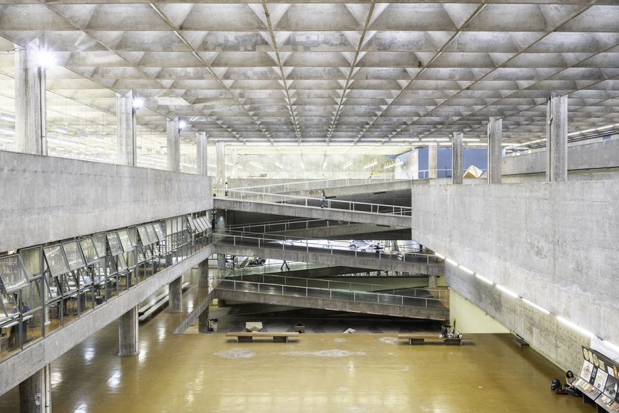 FAU-USP features a vast atrium illuminated from above through a sublime textile of interlocking concrete elements.
