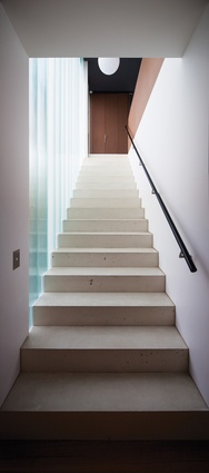 A concrete stair leads to the kids' area upstairs.