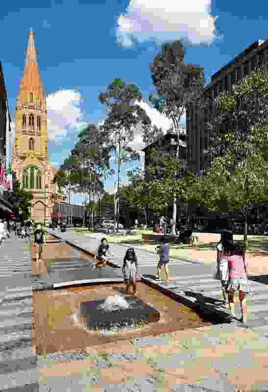 Children enjoy the City Square's new fountains.