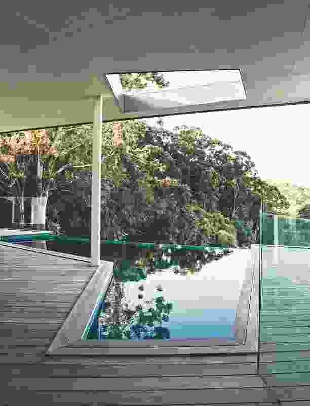 A fold in the plan creates a protected north-east-facing deck with views into the rainforest and to the ocean in the distance.