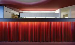 """The """"candy bar"""" reception desk made from standard timber mouldings and handrails."""