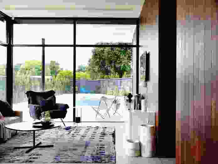 Floor-to-ceiling glazing provides a grand sense of space to the downstairs living room.