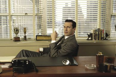 Don Draper (Jon Hamm) at his office desk in the TV show Mad Men (2007–).