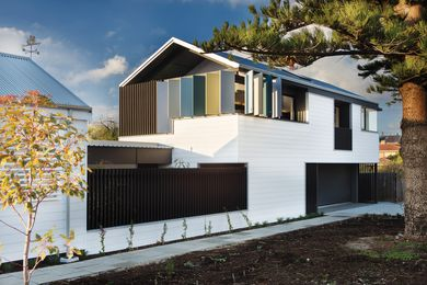 """The double-storey addition reinterprets the form of the heritage cottage to become its """"bigger sibling."""""""