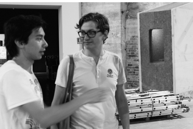 HY William Chan (left) talks with Kieran Long inside the Arsenale at the 2012 Venice Architecture Biennale.