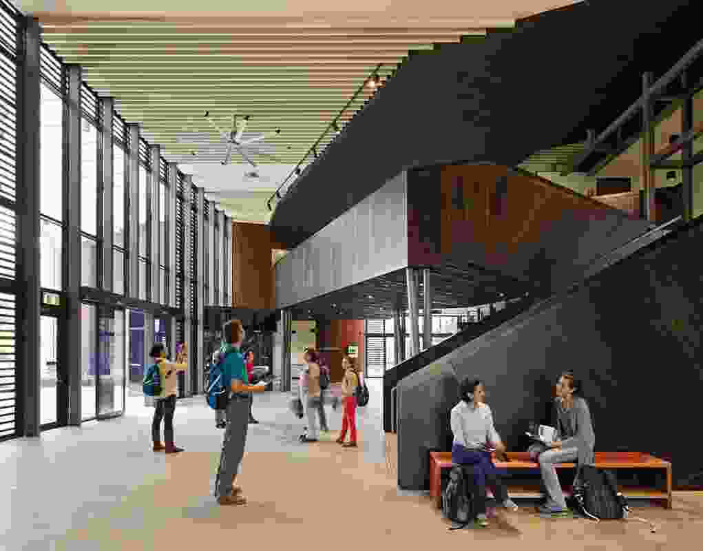 Three public entries lead into the central foyer, which separates the public zones of the Institute from the academic and administration areas.