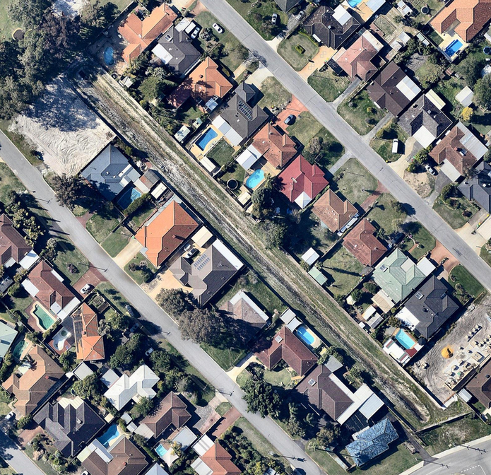 An aerial view of houses backing onto a 90-metre long open drain in Perth.