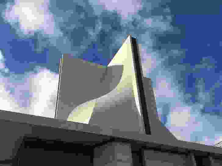 The concrete roof shell structure is a monolithic hyperbolic paraboloid.