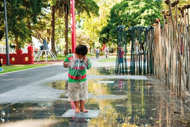 A waterplay playground by artist Fiona Foley and Urban Art Projects within the Redfern Park