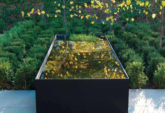 The bedroom courtyard is structured around an elegant reflective pool in the Adelaide villa garden.
