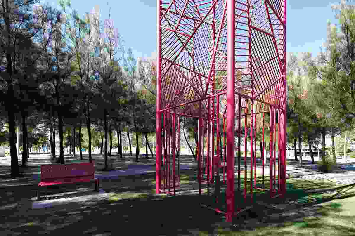"""Located in the Whispering Forest in Coolamon, Ellenbrook, this red sculpture was conceived and built by artist Phillipa O'Brien. The sculpture invites viewers to stand in the middle and look up at a """"framed"""" sky."""