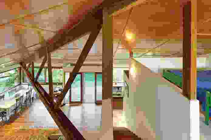 The ply ceiling folds over a triangulated truss.