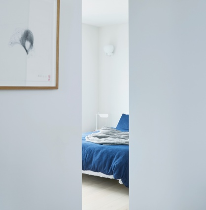 The corner room is designed to perform a variety of functions, from second bedroom to spacious office.