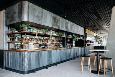 On the ground floor, House Bar features a patinaed copper bar at the rear of the space and seating with views to the harbour.
