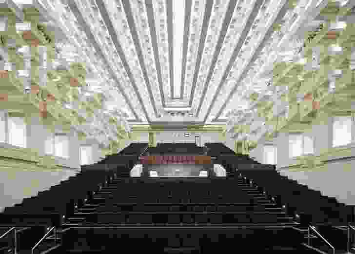 The new elements in the theatre are robust and recessive in order to let the delicate extravagance of the original ceiling shine forth.