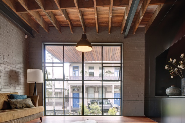 Exposed ceilings reveal the original construction of the upper levels' timber flooring.
