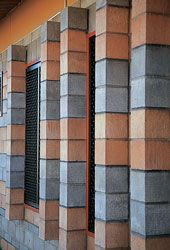 Banded block work and vertical sunshades.