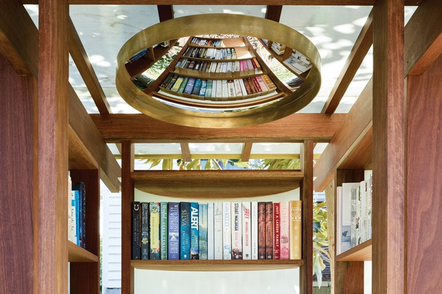 A hanging convex mirror offers a distorted view of the Ryan Street Footpath Library in Brisbane.