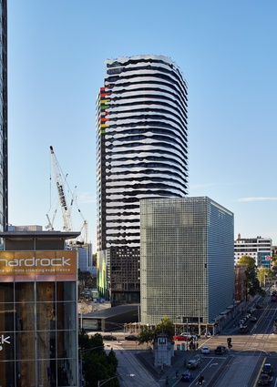 The apartment tower stands at the northern end of the Swanston Street civc axis that runs through Melbourne's CBD.