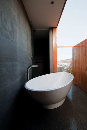 "The bathroom has a ""loo with a view"" and connects to a tiny deck."