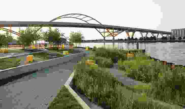 Designed by Stoss Landcape Urbanism, the Erie Street Plaza in Milwaukee, Wisconsin, can accommodate a wide variety of possible activities in addition to registering environmental cycles through a reconstituted marsh.