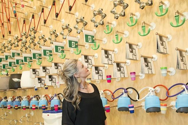 Curator/designer Simone LeAmon inspects <em>Design In Everyday Life 2013</em> created with Edmund Carter.