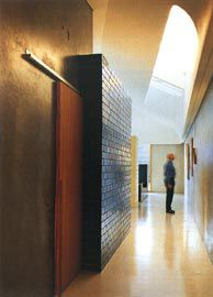 Looking along the east passage, with a tearshaped skylight above and blue glazed brick bathroom box to the left.