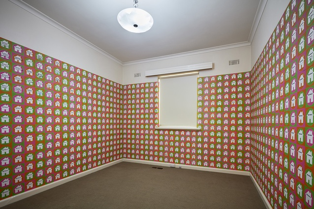 Stickers on the walls inside <i>Untitled House</i> by Roh Singh, Larry Parkinson and Morganna Magee.