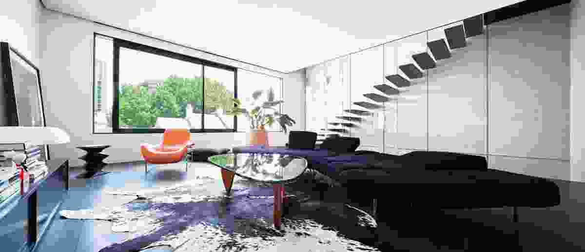 The living area is contained on the second floor, intended as an undefined and flexible space.