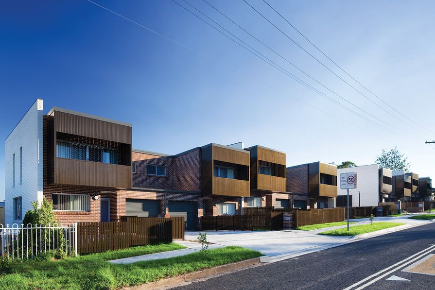 The project combines two-storey townhouses fronting Hope Street with single-storey villas accessed via a side street.