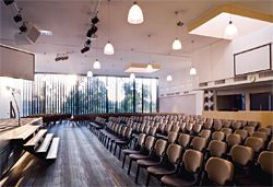 With louvres open the auditorium has extensive views over the treed suburban valley.