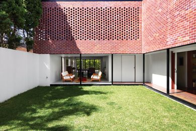 A private garden courtyard has become the pivotal point of all household activity.