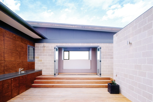 A sheltered outdoor area and sunny interior provide occupants with maximum winter light.