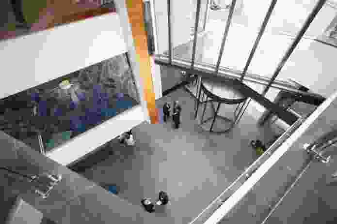 An oval-shaped three-storey atrium symbolizes a rugby league football.