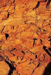The block work colours come from rock strata in the nearby hills.