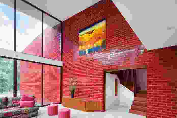Red glazed bricks contrast with the surrounding landscape.
