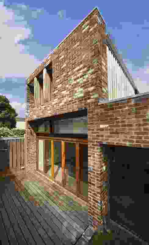 The rear facade is made from recycled brick found on site.