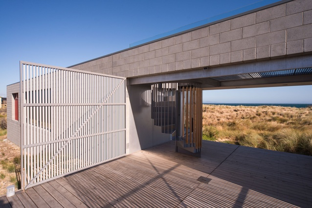 A timber entry deck splits the two pavilions.