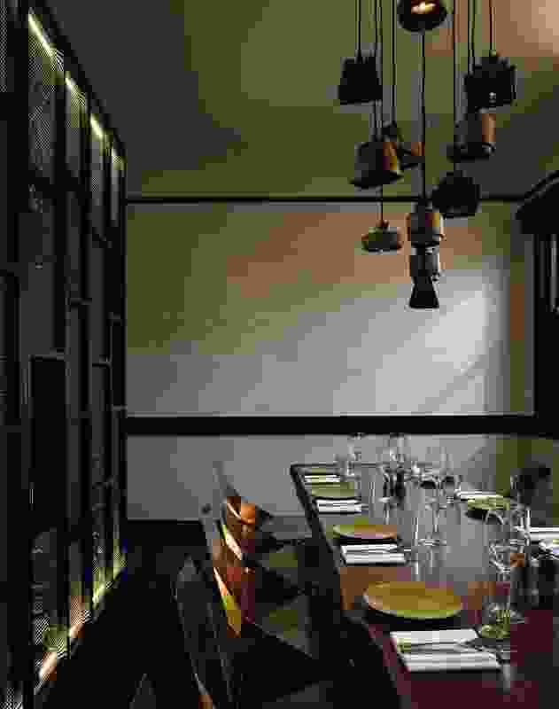 In the Copper Suite, a small private dining room, copper appears on the chairs and in the cascade of pendant lights.