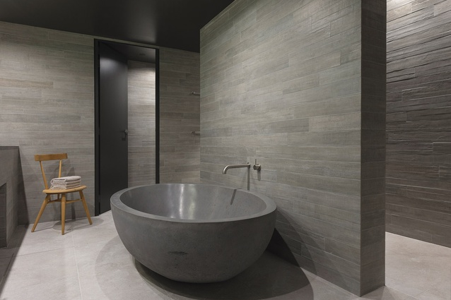 Some of the rooms' bathrooms feature a custom-made concrete bathtub.