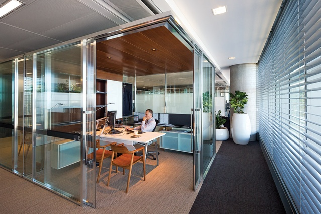 "Chrome-framed ""pavilions"" are pulled back from the edge of the perimeter so all staff can enjoy the views."