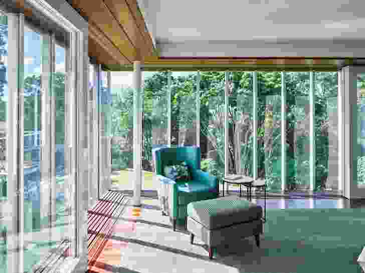 The main bedroom features expansive glazing that offers spectacular views across the property.